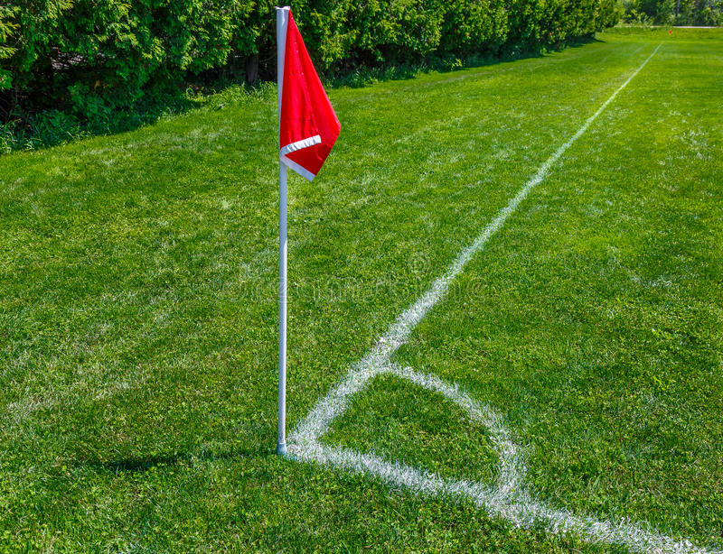 Soccer Field Pitch Red Flag stock photo
