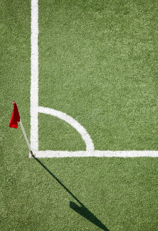 Soccer field and red color flag stock photos
