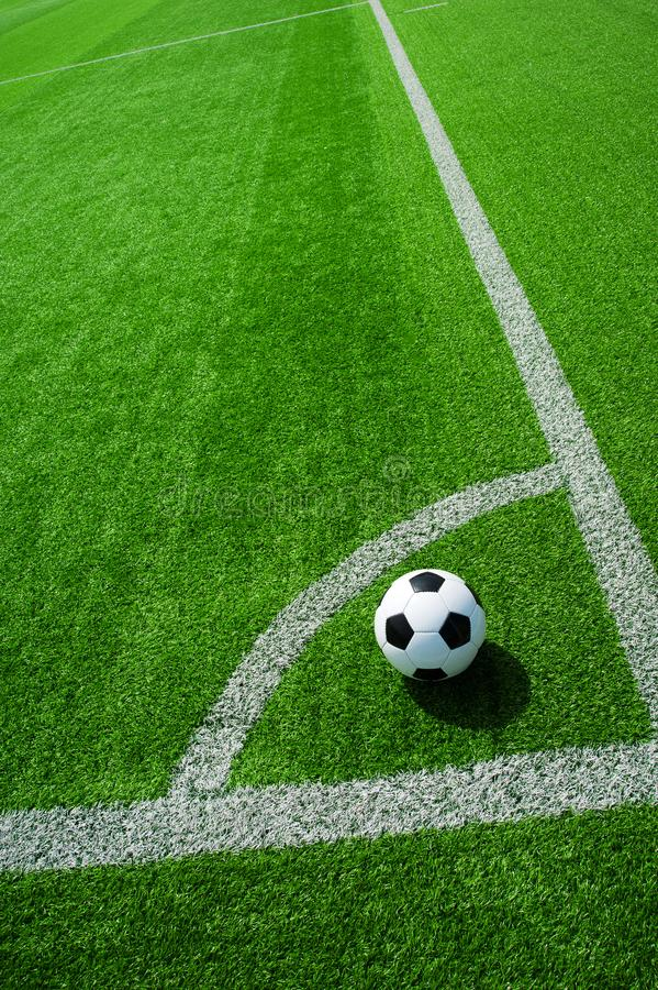 Soccer, football, ball, on corner spot, white marks, classic black and white on clean green field, space for text, good for banner. Soccer ball black and white stock images