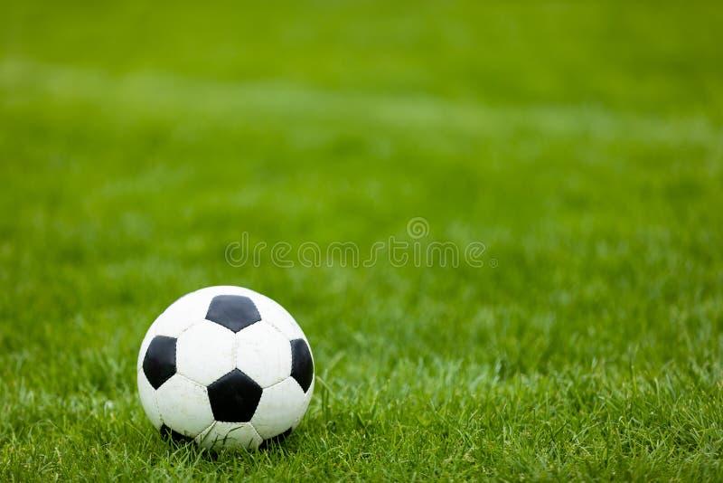 Soccer Football Ball on Soccer Field. Green Grass Soccer Pitch. Traditional Soccer Ball on Soccer Field royalty free stock photos