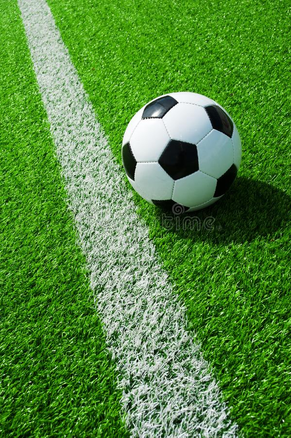 Soccer, football, ball, mark, white line, classic black and white on clean green field, space for text, good for banner. Soccer ball black and white on green stock images
