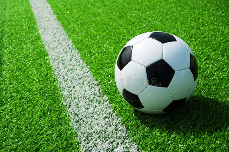 Soccer, football, ball, mark, white line, classic black and white on clean green field, space for text, good for banner. Soccer ball black and white on green royalty free stock photos