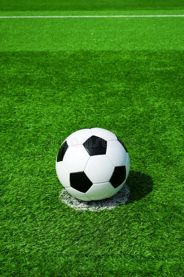 Soccer, football, ball, on penalty spot, classic black and white on clean green field, space for text, good for banner. Soccer ball black and white on green royalty free stock photo