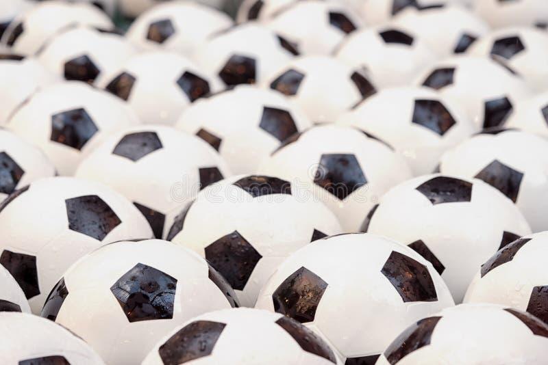 Soccer football balls. Group of wet soccer football balls full background stock image