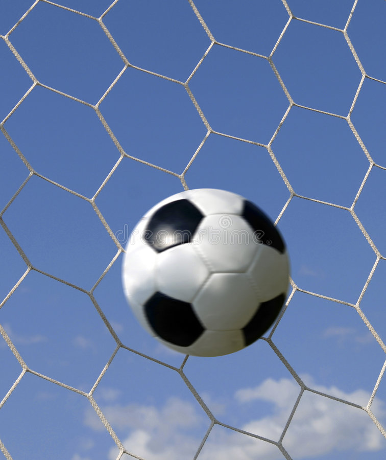 Soccer - football in Goal royalty free stock images