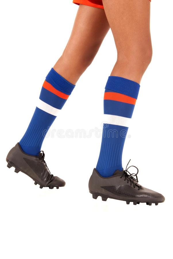 Soccer football legs knee socks and shoes or cleats. White background of soccer or football socks and cleats. Girl wearing soccer shoes royalty free stock images