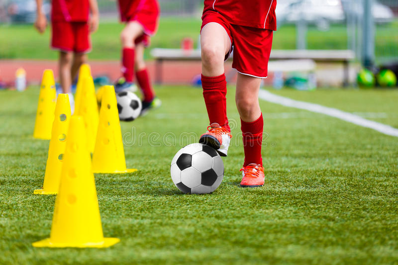 Soccer football players during the team training before the match. Exercises for football soccer youth team. Young player exercise. S with ball and marker cones royalty free stock images