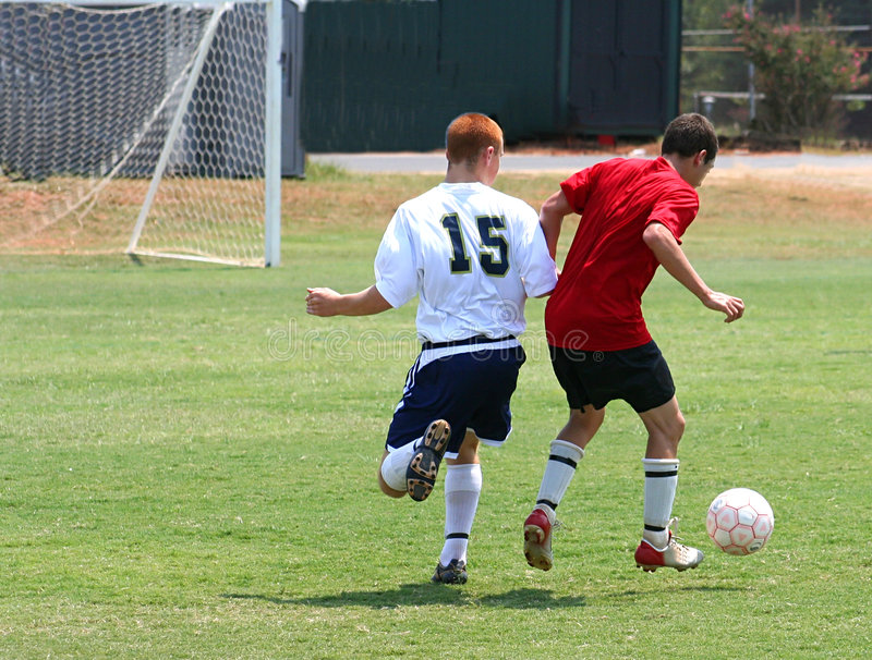 Soccer Game. Two soccer players competing for the ball royalty free stock photography
