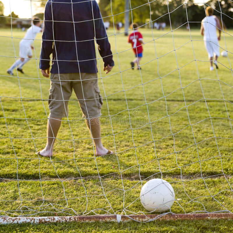 Download Soccer game with family stock image. Image of fitness - 9838729