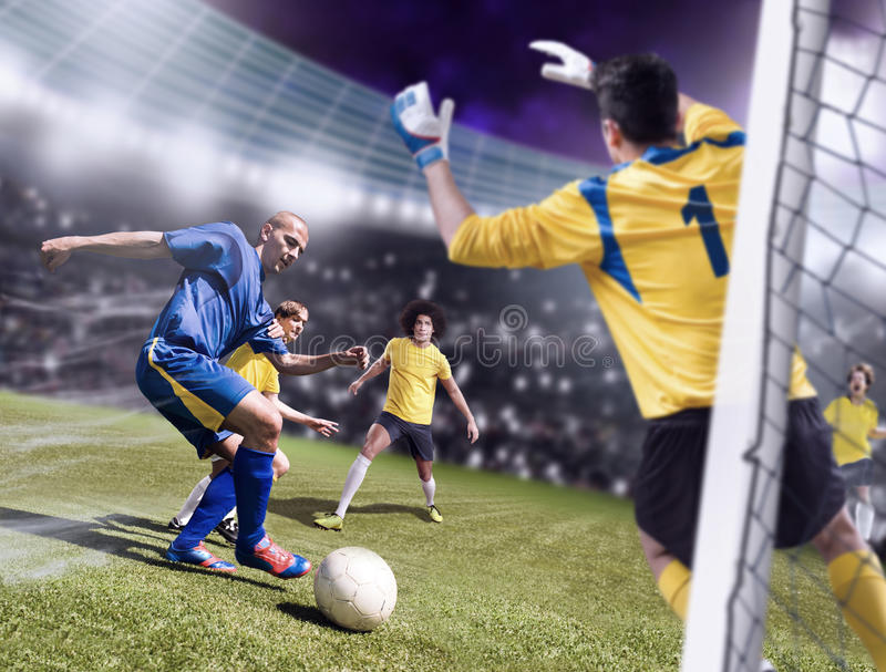 Soccer game. Soccer or football players from opposing team on the field royalty free stock photo