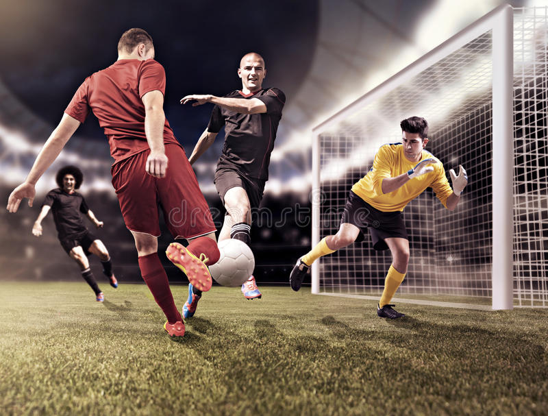 Soccer game. Soccer or football players from opposing team on the field royalty free stock photography