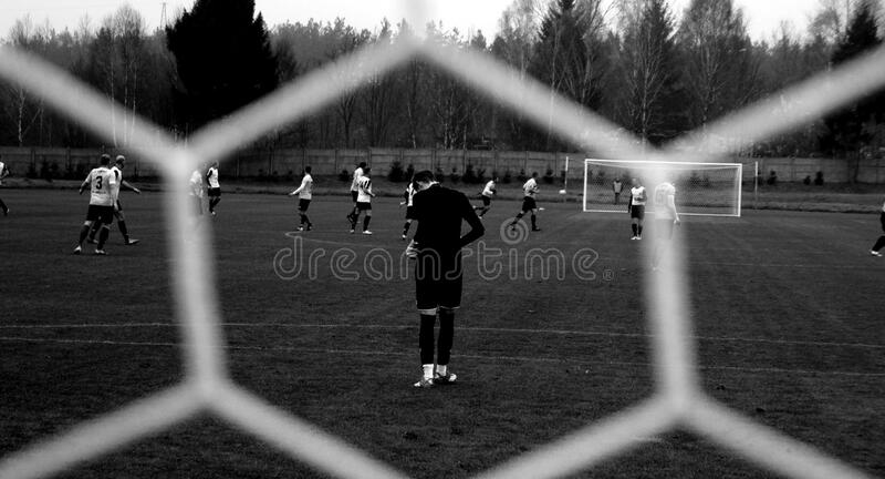 Soccer game through mesh net royalty free stock photos