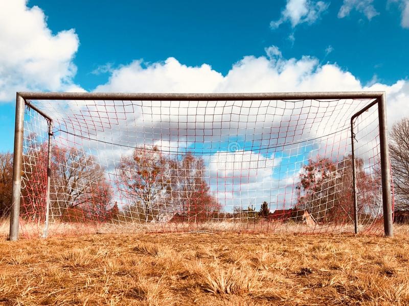 Soccer goal on countryside, low angle view of rural soccer field stock images
