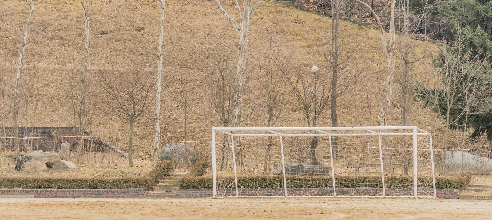 Soccer goal at the edge of a dirt field stock photos