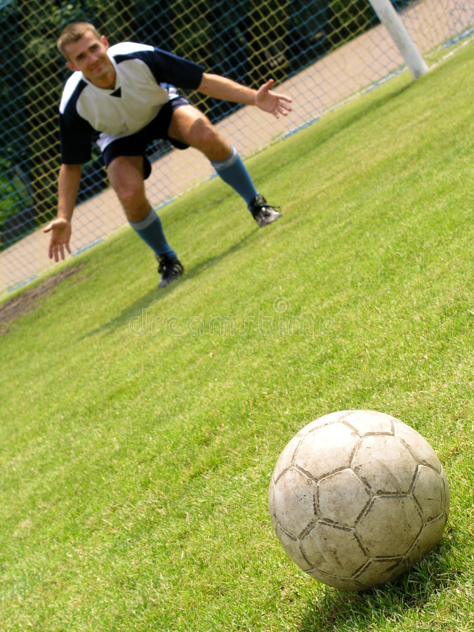 Soccer goalie. Concentrating stock image