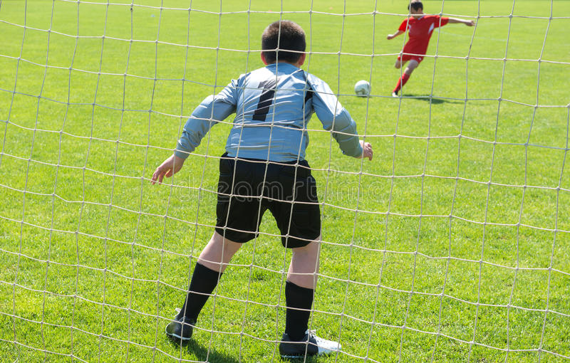 Soccer goalie. In action on the sports field stock images