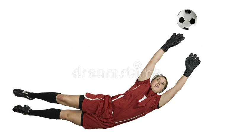 Soccer Goalie Jumping For Ball. Soccer Goalie leaps for the ball to block stock photo
