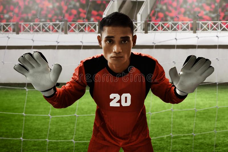 Soccer goalkeeper ready to catch the ball stock photo