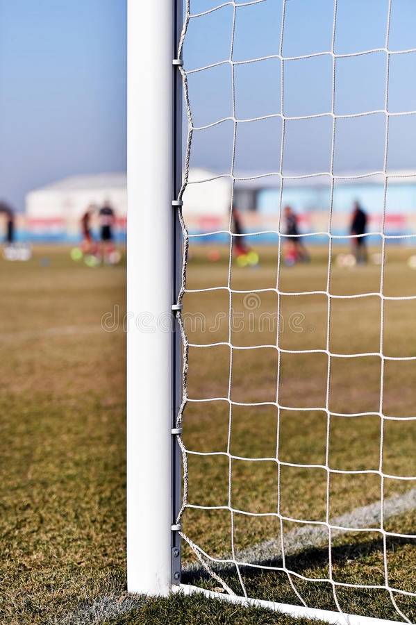Soccer goalpost and players training stock images