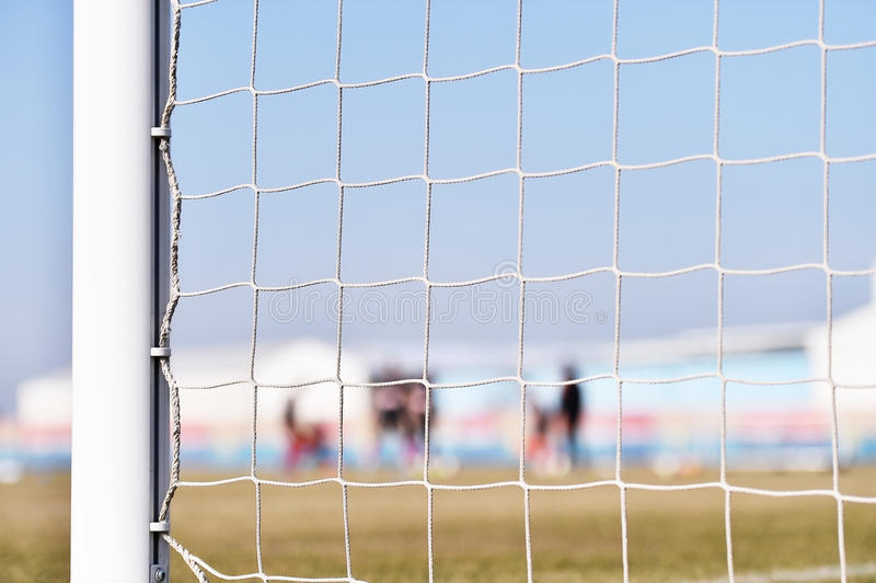 Soccer goalpost and players training stock photo