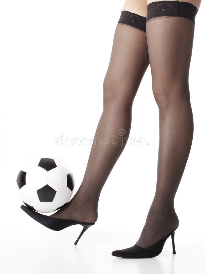 Soccer legs. Loegs with ball stock images