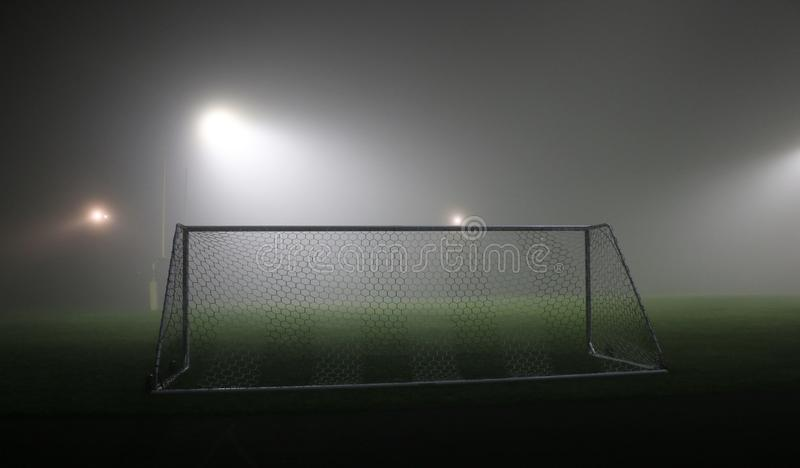 Soccer field at night in thick fog. royalty free stock photos