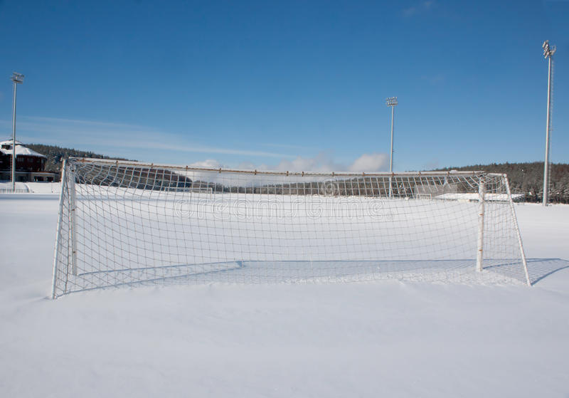 Soccer pitch in winter stock photography