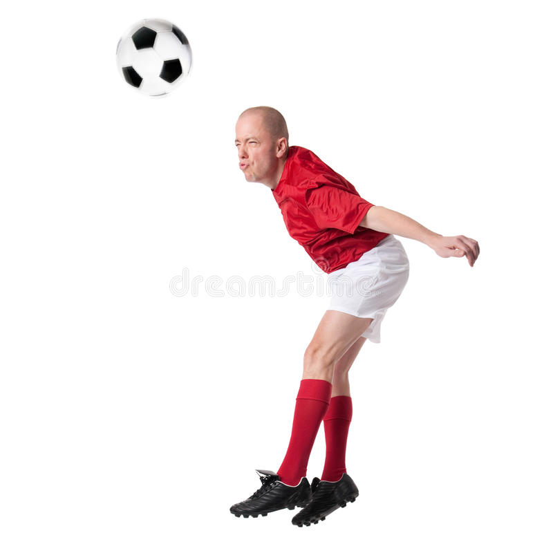 Soccer player. Full isolated studio picture from a young soccer player with ball royalty free stock image
