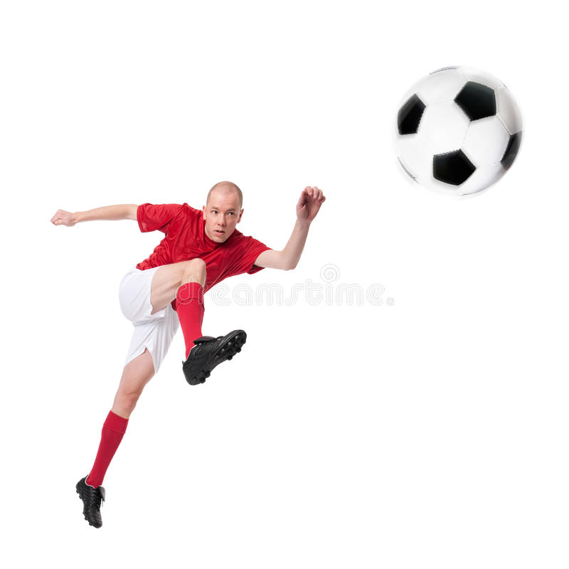Soccer player. Full isolated studio picture from a young soccer player with ball royalty free stock images