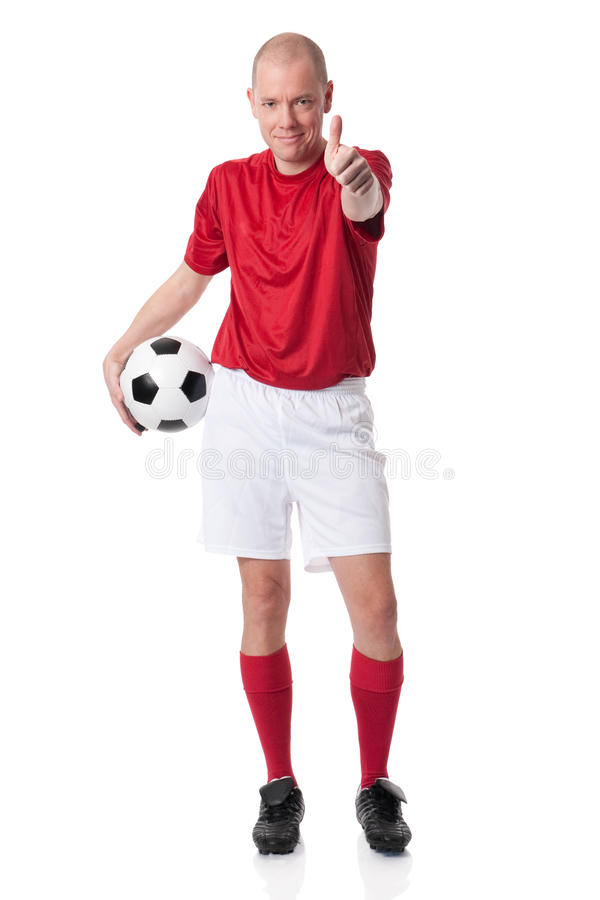 Soccer player. Full isolated studio picture from a young soccer player with ball stock photos