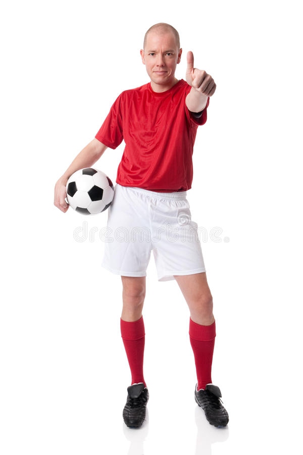 Soccer player. Full isolated studio picture from a young soccer player with ball stock images
