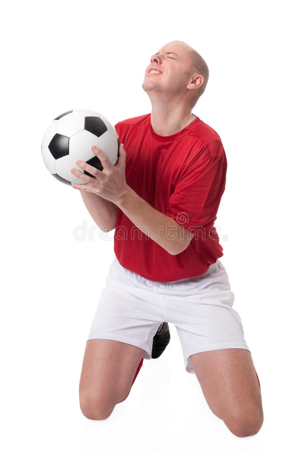 Soccer player. Full isolated studio picture from a young soccer player with ball stock photography