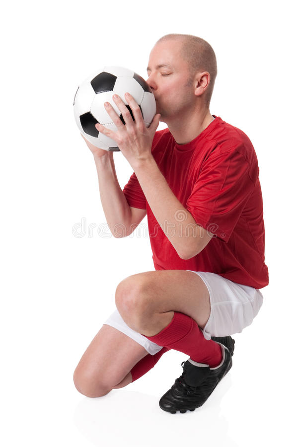 Soccer player. Full isolated studio picture from a young soccer player with ball royalty free stock photography