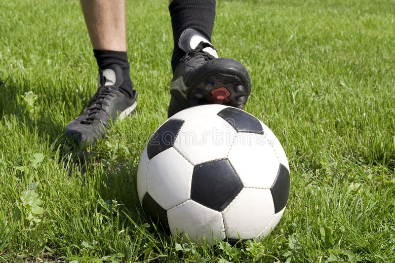 Soccer player. On green grass with ball royalty free stock photos