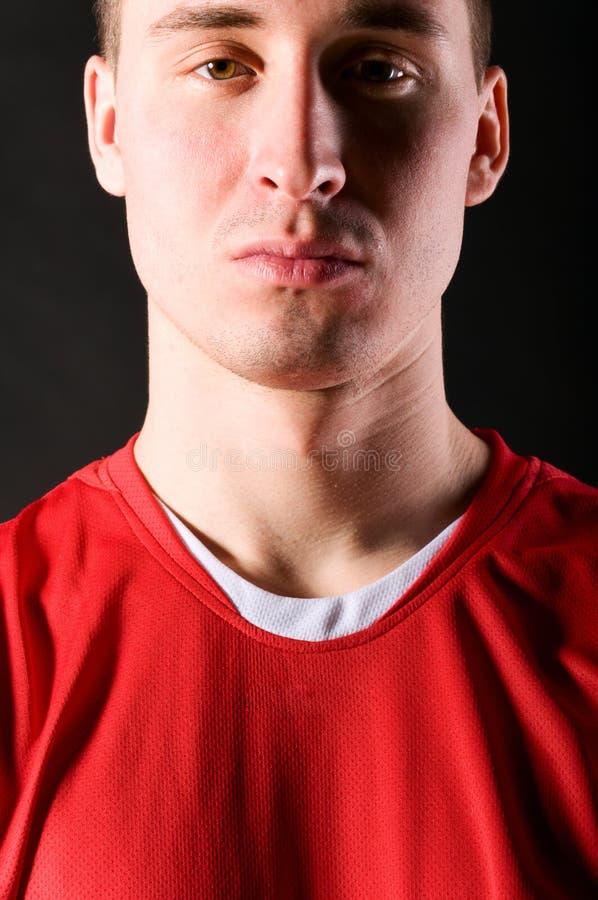 Soccer Player In Dark Stock Image