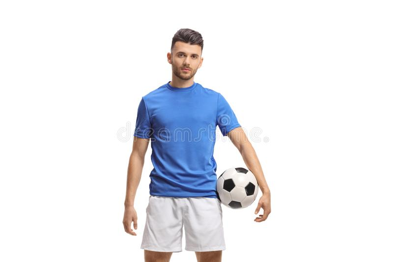 Soccer player with a football and looking at the camera stock image