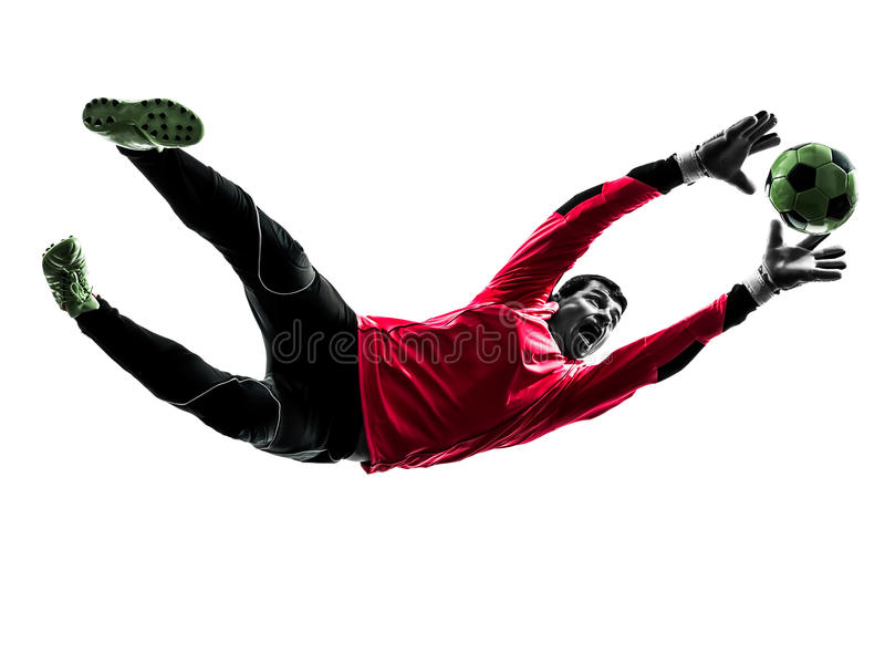 Soccer player goalkeeper catching ball silhouette stock photo