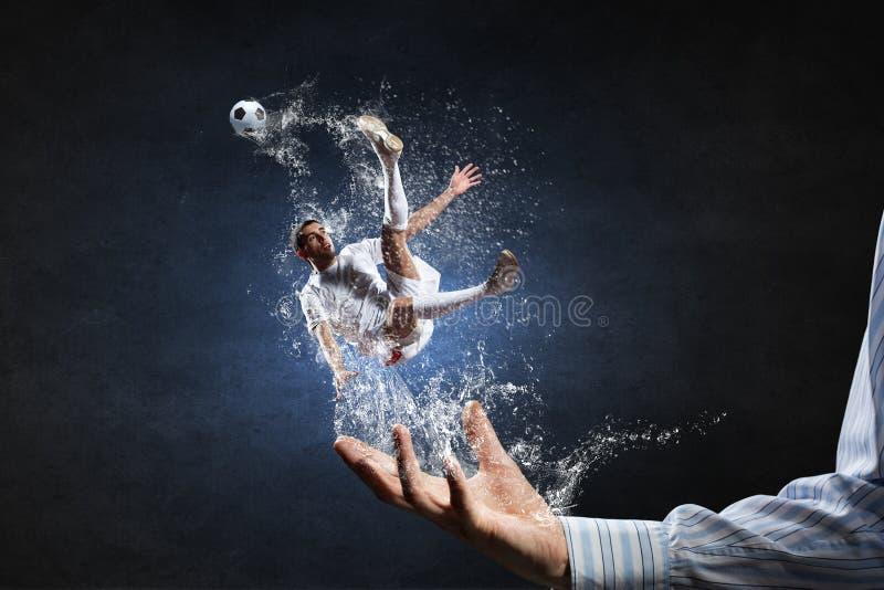 Soccer player kicking ball stock photos