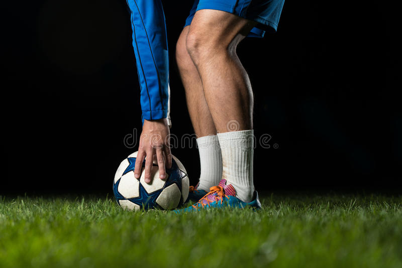 Soccer Player Positions The Ball. On Black Background stock images