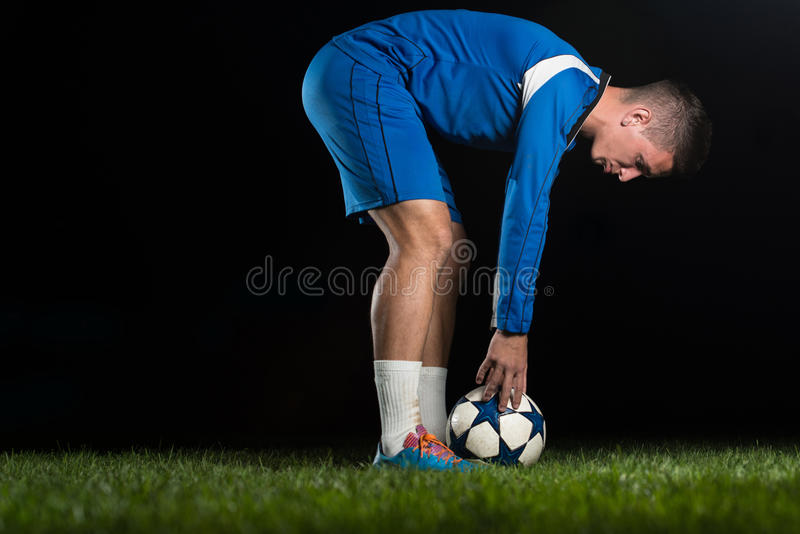 Soccer Player Positions The Ball. On Black Background stock photos