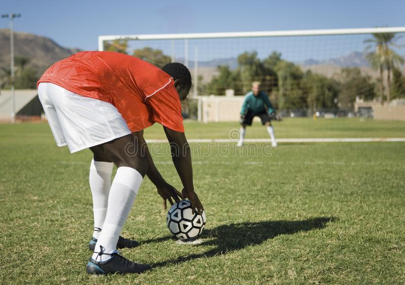 Soccer player preparing for penalty kick royalty free stock photo
