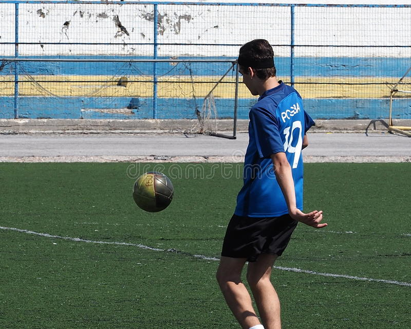 Soccer Player In Rethymno Crete Greece. Boys playing soccer or football in Rethymno Crete Greece stock photography