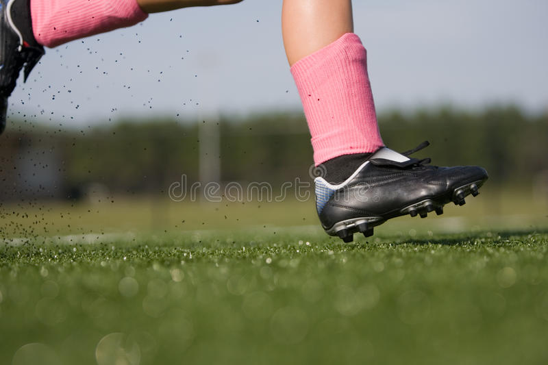 Download Soccer player running stock photo. Image of summer, cleats - 10839780