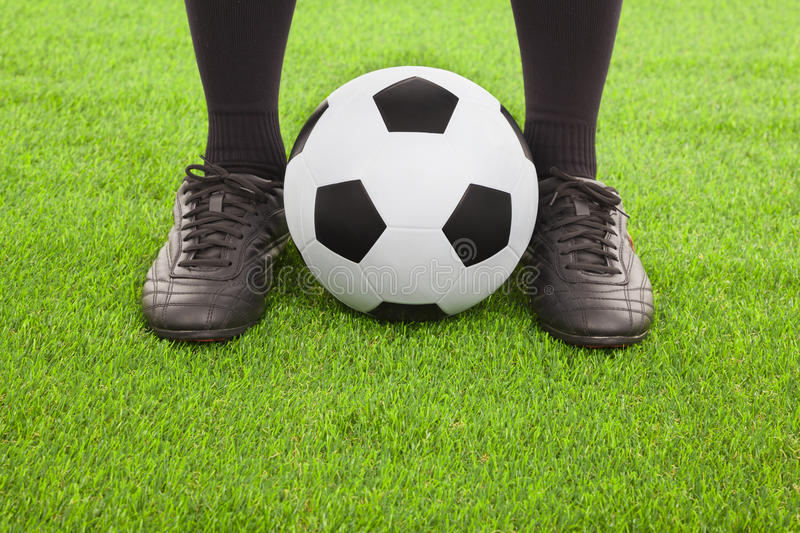 Soccer player's feet with ball. On an open playing field stock photography