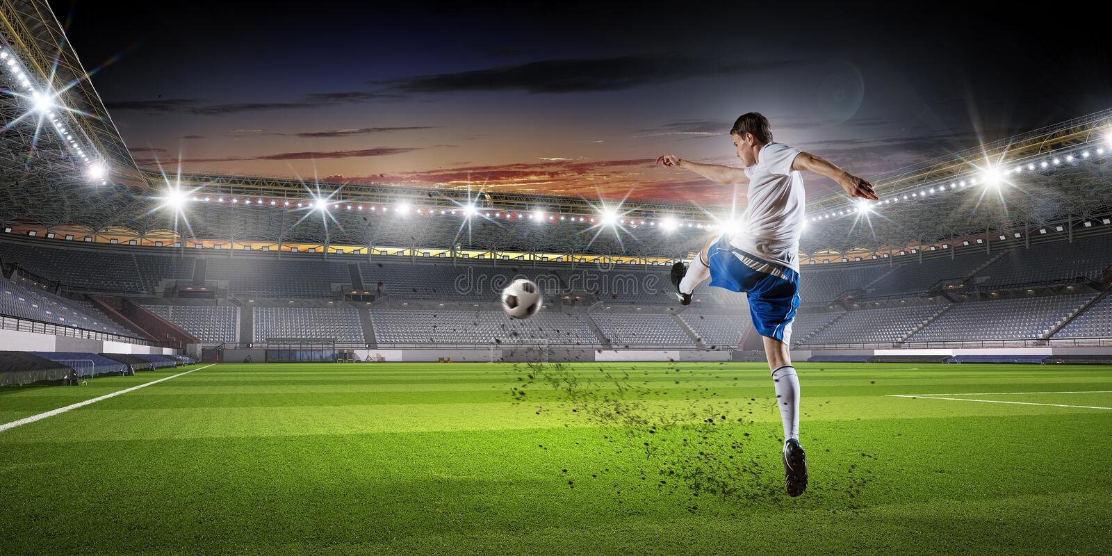Soccer player at sport arena . Mixed media royalty free stock images