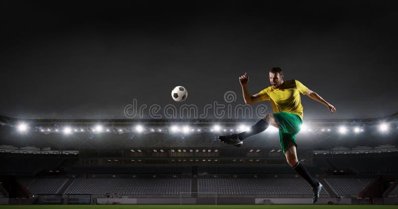 Soccer player at sport arena . Mixed media stock photos