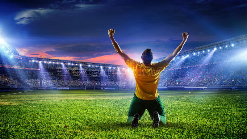 Soccer player at stadium. Mixed media. Sport arena and soccer player celebrating victory. Mixed media stock photo