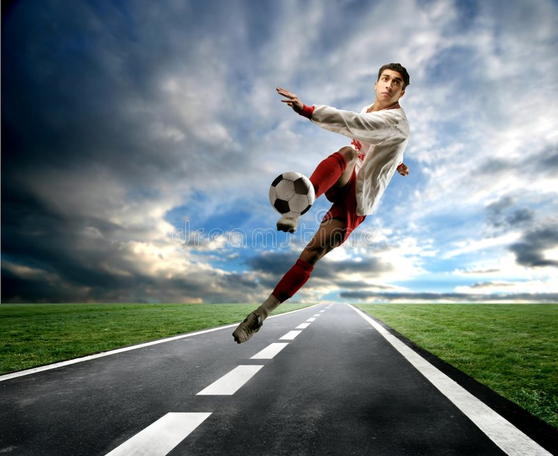 Soccer player on the street royalty free stock photo