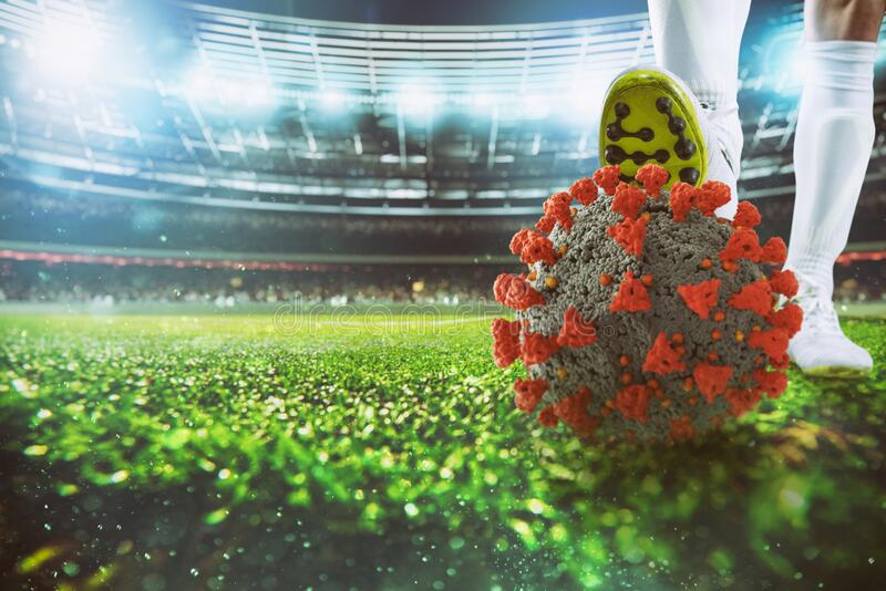 Soccer player with virus ball under the football shoe at the stadium stock images