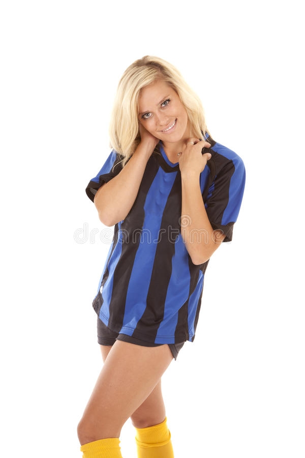 Soccer player yellow socks. A woman in her black and blue striped uniform with a serious expression on her face royalty free stock images